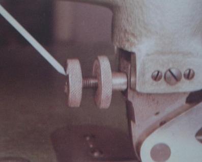 Pressure foot adjusting screw and locking nut