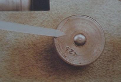 Sharpening stone adjusting thumb nut