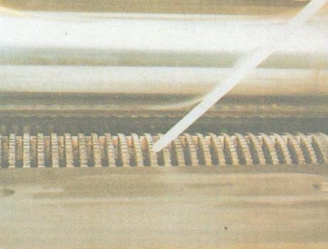 Bottom feed roller