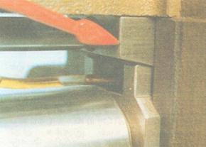 Top feed roller height adjusting wedges